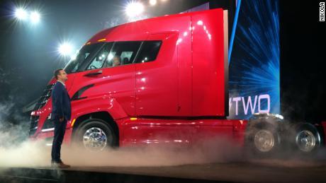 Former Nikola executive chairman Trevor Milton stands next to a truck at Nikola World 2019.