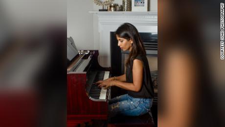 Sheena Melwani at her piano. In her videos, her offscreen heckler is never seen.