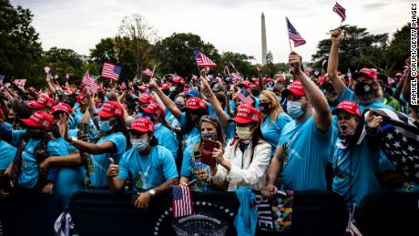 Supporters cheer as President Donald Trump makes remarks on law and order on the South Lawn of the White House on Saturday, where there was little social distancing. (Samuel Corum/Getty Images)