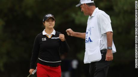 Kim fist bumps her caddy during the final round at the Women's PGA Championship.