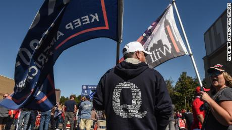 A man wears a QAnon sweatshirt during a pro-Trump rally on October 3, 2020 in the borough of Staten Island in New York City. The event was held to encourage supporters to pray for Trump's health after he contracted Covid-19.