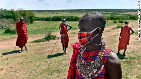 Cultural performers from the Maasai tribe wear masks in the Maasai Mara National Reserve, where their work of performing for visiting tourists has dwindled.