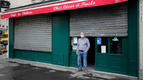 Caesar, from Portugal, stands in front of his bar in Paris on October 6, 2020, after all the city's bars closed under the new Covid-19 restrictions.
