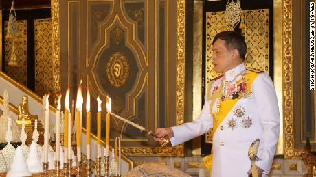 King Maha Vajirlongkorn of Thailand lights candles as he participates in a Buddhist ceremony on October 10, 2020 at the Wat Ratchabofit in Bangkok to mark the 2020 Kathina festival.