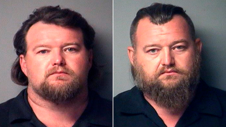 Michael Null, left, and William Null are featured in the photo booking provided by the Antrim County Sheriff.