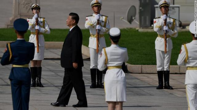 Chinese President Xi Jinping walks to the Monument to the People's Heroes during a wreath laying ceremony to honour deceased national heroes on Martyrs Day in Beijing's Tiananmen Square on September 30.