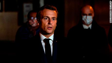 French President Emmanuel Macron speaks in front of the school of the murdered teacher in the Conference Saint-Nourine.