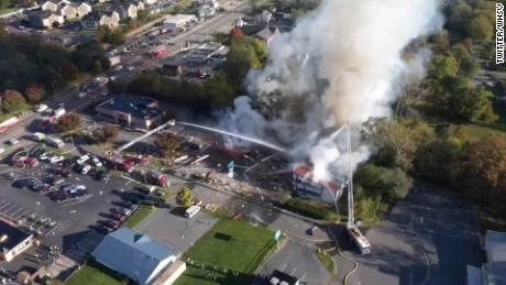 An aerial view after the blast shows fire crews at work.