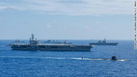 Ships from the Indian Navy, Japan Maritime Self-Defense Force (JMSDF) and the US Navy sail in formation during Malabar 2018.