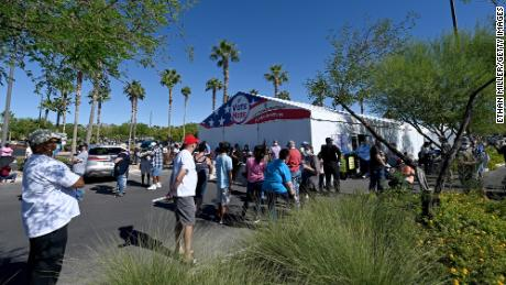 People line up to vote at a shopping center on October 17, 2020 in Las Vegas.