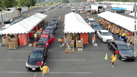 People line up in their cars to receive food during a Second Harvest pop-up distribution site at California's Honda Center in June.