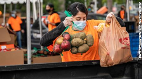 As another wave of the pandemic approaches, the nation's food banks are being hit on three fronts