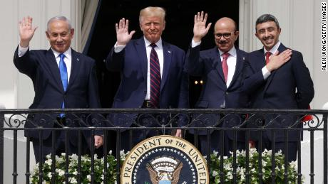 Israeli Prime Minister Benjamin Netanyahu, President Donald Trump, Bahraini Foreign Minister Abdullatif bin Rashid Al Zayani, and UAE Foreign Minister Sheikh Abdullah Bin Zayed wave from a White House balcony after the signing ceremony of the Abraham Accords on September 15.