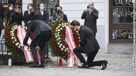 Austrian Chancellor Sebastian Kurz kneels  to lay a wreath on Tuesday near the site of the attack.