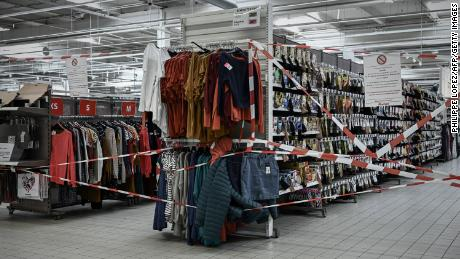 A notice is displayed at the closed clothing department of a supermarket in Bordeaux on Wednesday, on the sixth day of national lockdown.