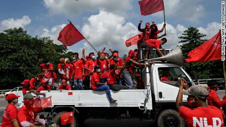 Supporters of the National League for Democracy (NLD) party take part in an election campaign rally on the outskirts of Yangon on October 25.
