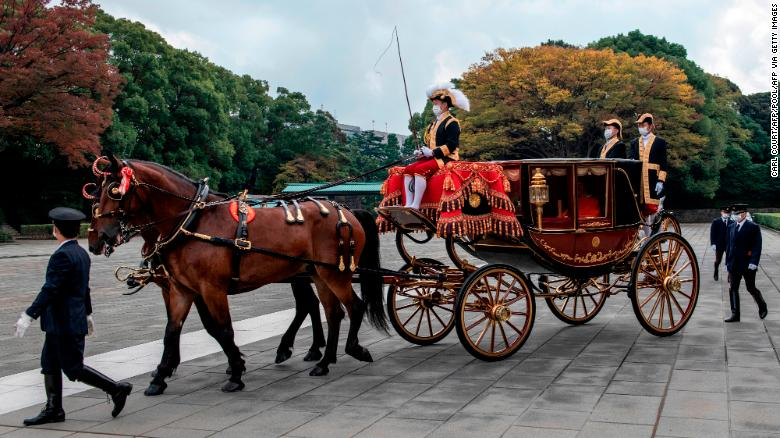 Crown Prince Akishino of Japan leaves the Imperial Palace in a horse drawn carriage in Tokyo on November 8.