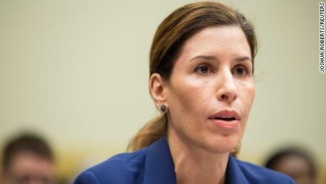 """Luciana Borio, director of the Office of Counterterrorism and Emerging Threats, testifies before a House Foreign Affairs Subcommittee hearing on """"global efforts to fight Ebola"""" in Washington on September 17, 2014."""