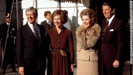 President-elect Ronald Reagan and wife Nancy stand with President Jimmy Carter wife Rosalynn outside the White House on November 1, 1980.