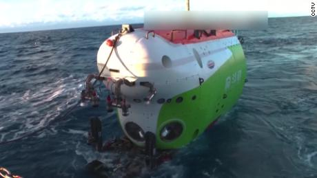 In an undated photo, manned submersible Fendouzhe is filmed being put into sea.