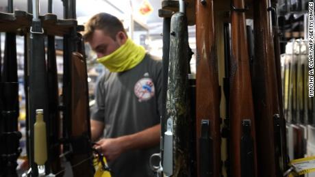 A customer looks at long guns at Coliseum Gun Traders Ltd. in Uniondale, New York on September 25, 2020.