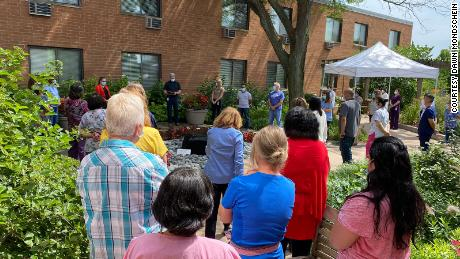 Central Baptist Village in Norridge, Illinois, held a socially distanced ceremony for one of its beloved nurses who died of Covid-19.