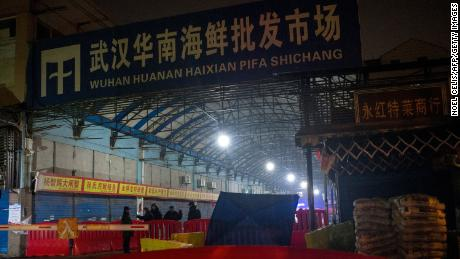 Security guards stand in front of the closed Huanan Seafood Wholesale Market in the city of Wuhan, in the Hubei Province, on January 11.