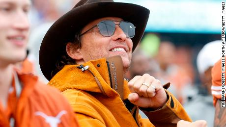 McConaughey celebrates on the Texas Longhorns sideline in the second half against the Texas Tech Red Raiders at Darrell K Royal-Texas Memorial Stadium on November 29, 2019 in Austin, Texas.