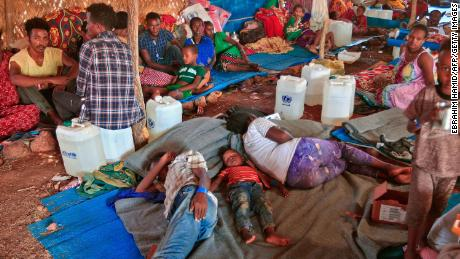 Ethiopian refugees who fled fighting in Tigray province lie in a hut at the Um Rakuba camp in Sudan's eastern Gedaref province, on November 18, 2020.
