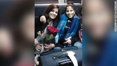 Lina al-Hathloul and her sister Loujain pictured in an undated photo on a train from Brussels.