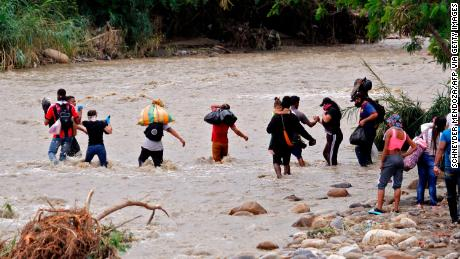 Venezuelans attempt to cross the Tachira river in Cucuta, Colombia.