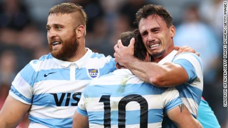 Argentina's Juan Imhoff (rights) reacts to his side's victory over New Zealand.