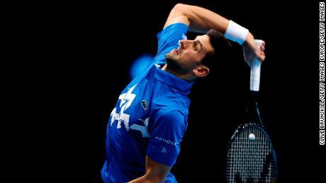 Djokovic serves in his match against Thiem.