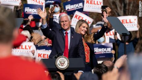 Vice President Mike Pence and Georgia Sen. Kelly Loeffler wave to the crowd during a Defend the Majority Rally, in Canton, Georgia, on Nov. 20, 2020.