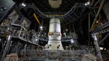 """<strong>2020:</strong> NASA engineers have started to assemble the massive rocket designed to take <a href=""""https://edition.cnn.com/2020/11/25/americas/nasa-sls-moon-rocket-assembly-scn-trnd/index.html"""" target=""""_blank"""">the first woman and the next man to the moon in 2024</a>, as part of the Artemis program. The first booster segment of the Space Launch System (SLS) was stacked on top of the mobile launcher in preparation for its maiden flight next year. Once fully assembled, the SLS rocket will stand taller than the Statue of Liberty and have 15% more thrust at liftoff than the Saturn V rocket -- making it the most powerful rocket ever built.<br />"""