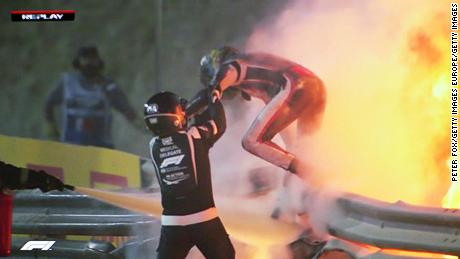 Romain Grosjean emerges from the flames of the crash.