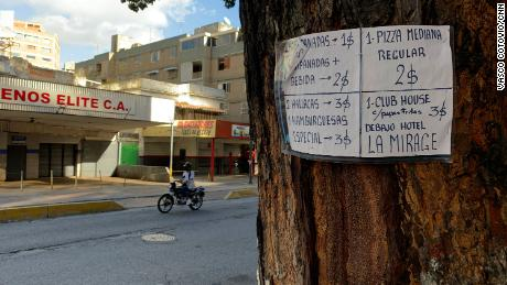 A sign in a Venezuelan neighborhood  illustrates the dollarization of the economy.