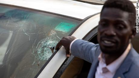 Bobi Wine says police shot through the window of his vehicle as he attempted to pass a roadblock on December 1.