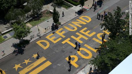 """""""Defund The Police"""" was painted on 16th Street near the White House on June 8, 2020, in Washington."""