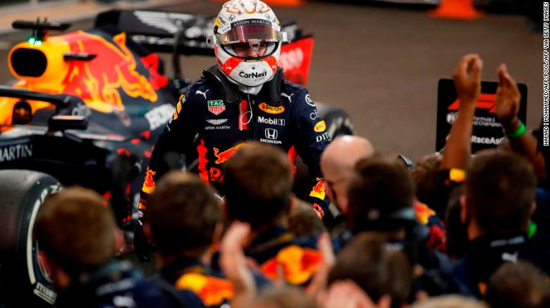 Red Bull's Max Verstappen celebrates with the team after winning the Abu Dhabi GP.