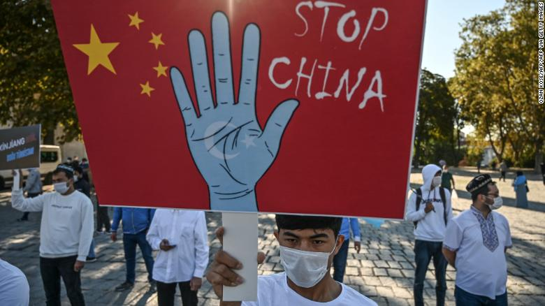 Supporters of China's Uyghur minority hold placards as they gather at the Beyazit Square on October 1, 2020 during a demonstration in Istanbul, Turkey.