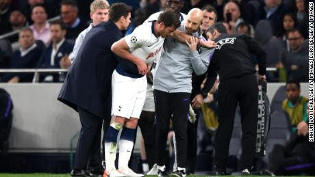 Vertonghen is helped from the field during Tottenham's Champions League game against Ajax in 2019.