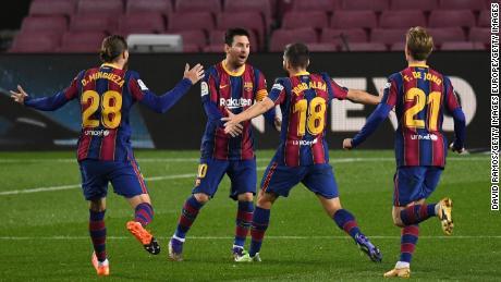 Jordi Alba celebrates Messi after scoring the opening goal of Barcelona.