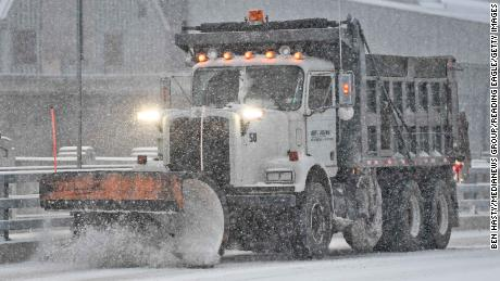 A truck with a plow drives over the Penn Street Bridge out of Reading, Pennsylvania, on Wednesday.