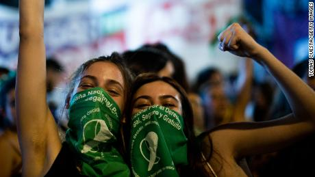 Activists celebrate after Argentina's lower house approved a bill to legalize abortion on December 10.