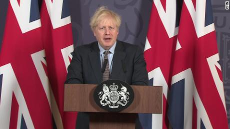Boris Johnson is surrounded by the Union flag