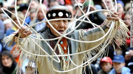 Navajo elder Jones Benally performs a traditional hoop dance at a festival in Germany in 2008.