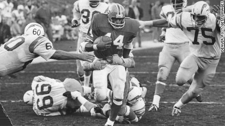 Floyd Little playing for the Broncos in December 1971, the season in which he won the NFL racing title.