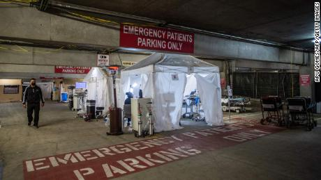 Dr. Thomas Yadegar walks Sunday in a temporary emergency room built into a parking garage at Providence Cedars-Sinai Tarzana Medical Center in Tarzana, California.
