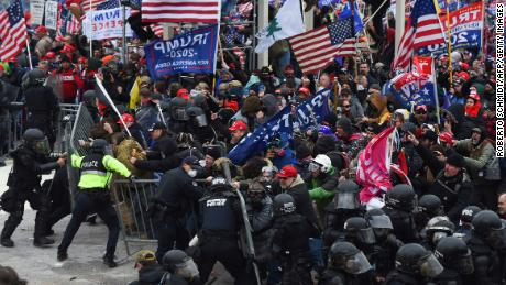 Trump supporters clash with police and security forces as they push barricades to storm the US Capitol on January 6.
